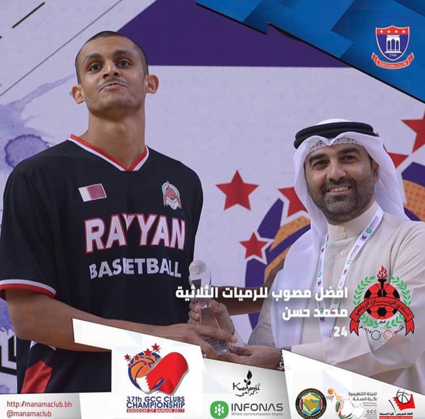 Mizo Amin holding the best 3 point shooter in the gulf region Trophy