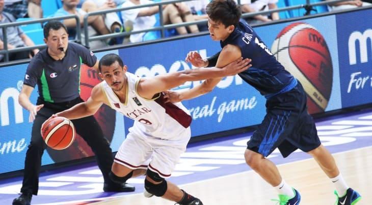 Mizo Amin driving to the basket against korea
